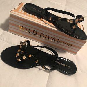 Patent studded bow sandal